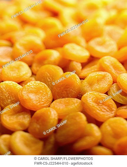 Apricot, Prunus armeniaca, A mass of dried apricots