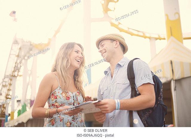 Young couple with map, Santa Monica, California, USA