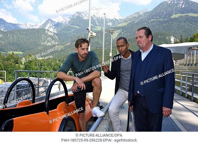 24 July 2018, Schönau am Königsee, Germany: The actors Ben Blaskovic (role of Tom Aureiner L-R), Peter Marton (role of Commissioner Jerry Paulsen) and Andreas...