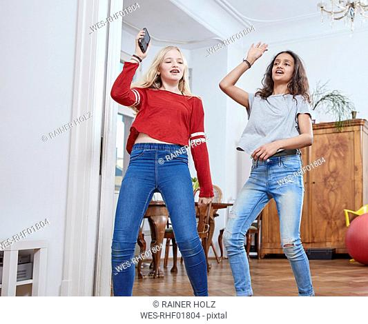 Two girls dancing at home