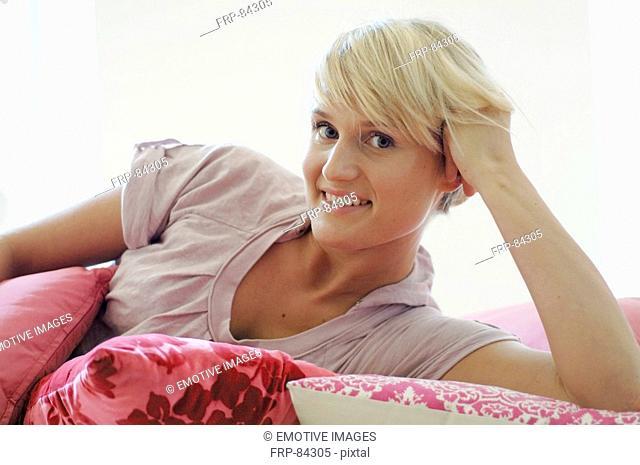 Blonde woman on sofa