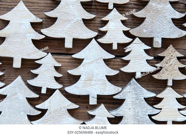 Close Up Or Macro Of Christmas Trees On Brown Wooden Background With Copy Space For Your Text Here Or Free Text. Vintage Style