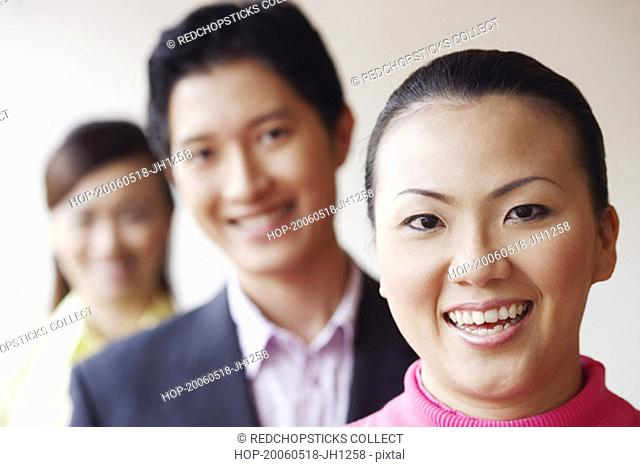 Portrait of a businesswoman smiling with her colleagues