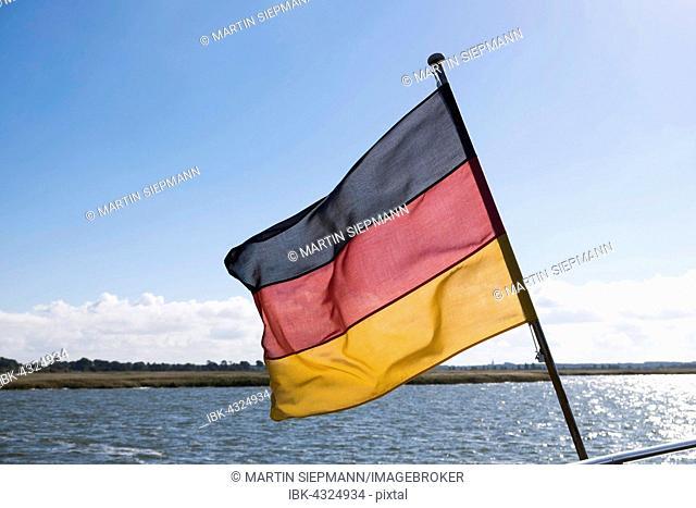 German flag on a ship, Bodstedter Bodden, Fischland-Darß-Zingst, Western Pomerania Lagoon Area National Park, Baltic Coast, Mecklenburg-Western Pomerania