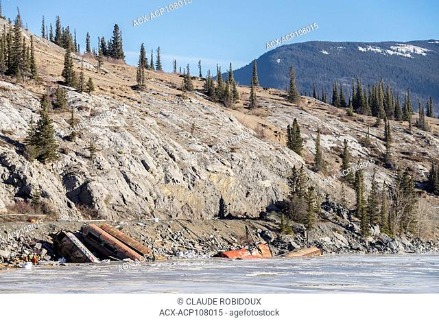Crew assessing a freight train derailment in the frozen Athabasca River in Jasper National Park, Alberta, Canada