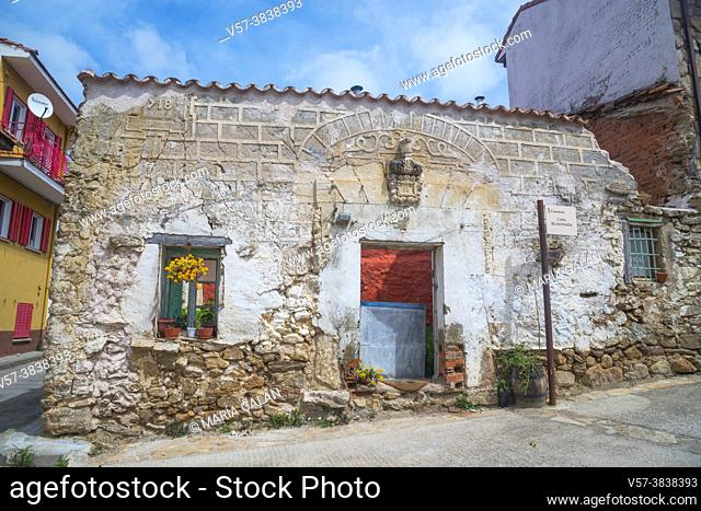 Facade of house in ruins. Canencia, Madrid province, Spain
