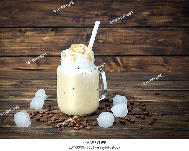Ice coffee in a glass mug with drops of water on its surface