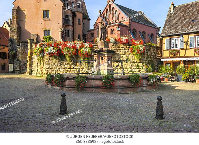 village Eguisheim, castle and well in the old town and tourist destination of the Alsace, France