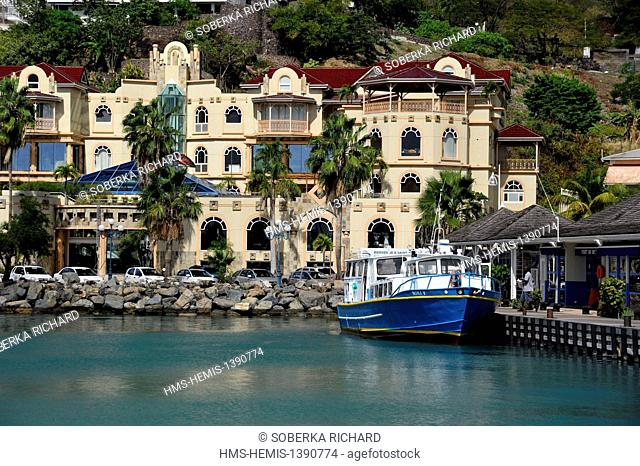 France, French West Indies, Saint Martin island, Marigot, boat moored in the harbor station next to the shopping center