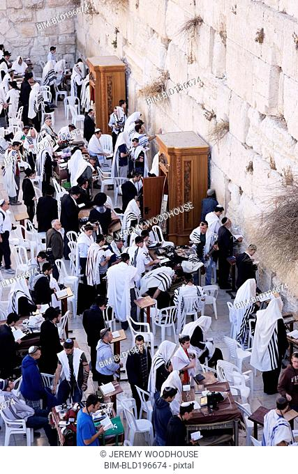 Men worshipping at the Western Wall
