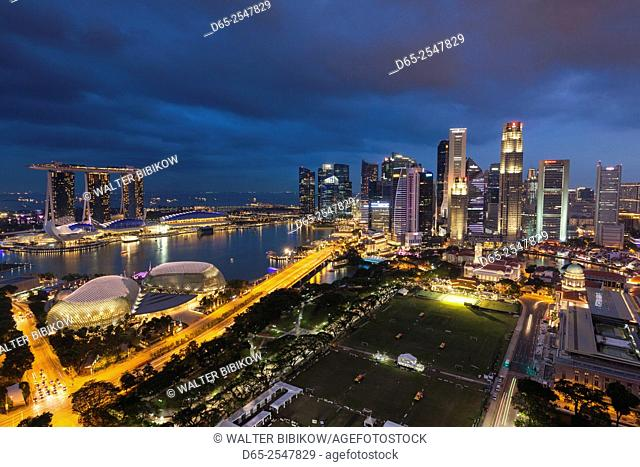 Singapore, city skyline elevated view above the Padang, dusk