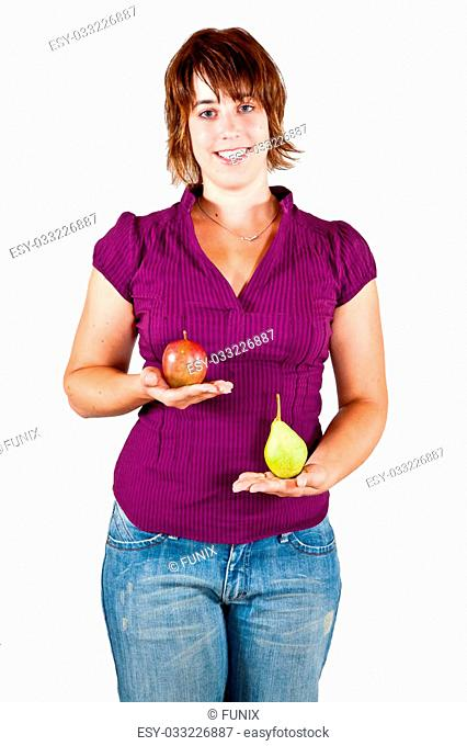 A young Women has the Balance with an Apple an Pear