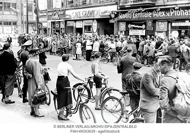 The photo from a Nazi news report shows a crowd of people outside of the Radio-Zentrale Alex von Prohaska during the special announcement about the French...