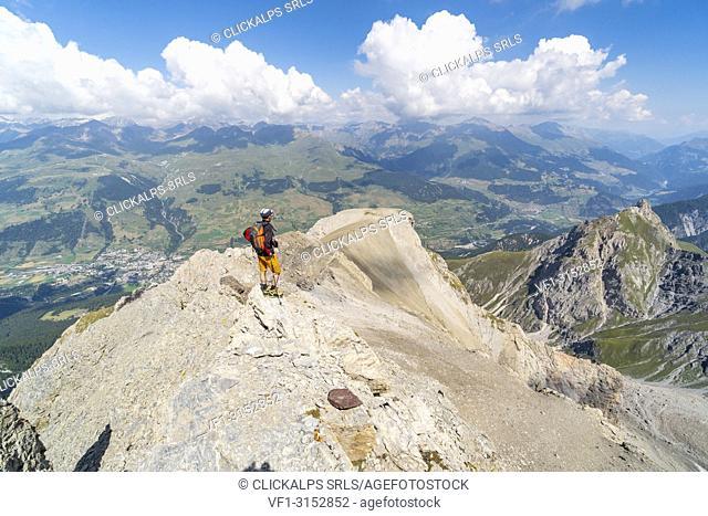 An hiker on the top of Piz lischana. Scuol, Engadin, Switzerland