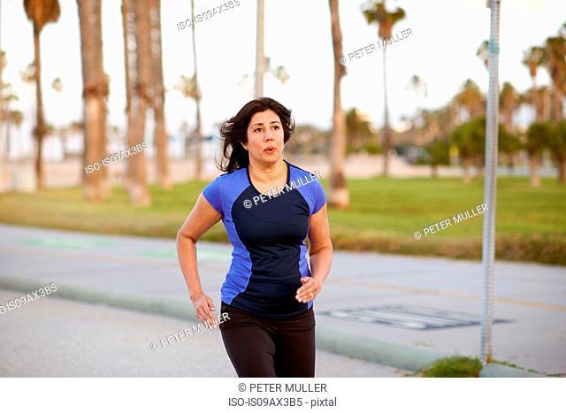 Woman wearing sports clothing jogging