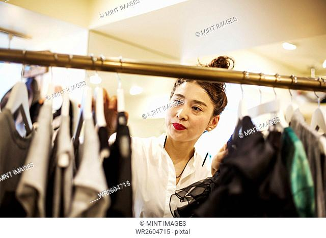 Woman working in a fashion boutique in Tokyo, Japan