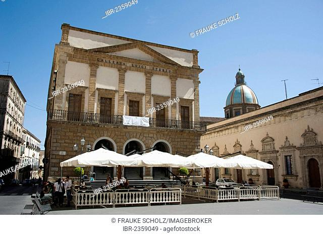 Casa Senatoria building on the main square with the Palazzo de la Corte Capitaniale palace, dome of the Cathedral of San Giuliano at the back, Caltagirone