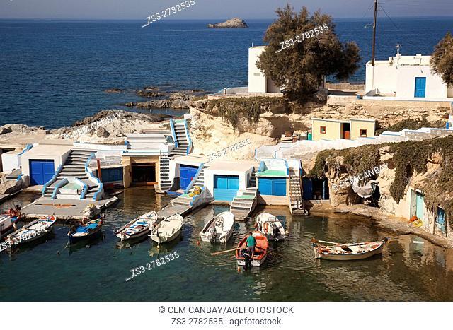 Fisherman on a traditional fishing boat in Mandrakia village, Milos, Cyclades Islands, Greek Islands, Greece, Europe