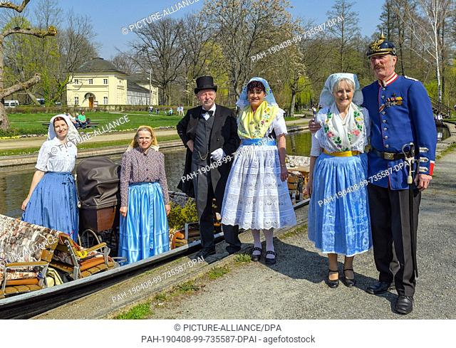 06 April 2019, Brandenburg, Lübbenau: Women in Sorbian-Wendish festive costumes and other people in historical costumes will take part in the opening of this...