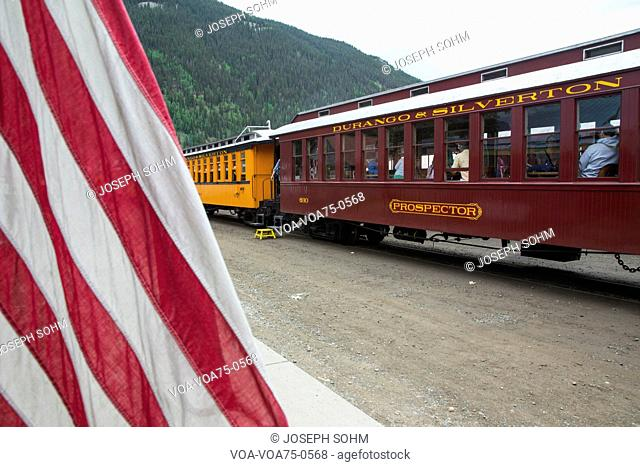 US Flag and Durango and Silverton Narrow Gauge Railroad Steam Engine Train, Silverton, Colorado, USA