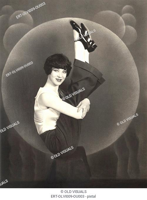 Woman holding her legs up in the air, 1930s
