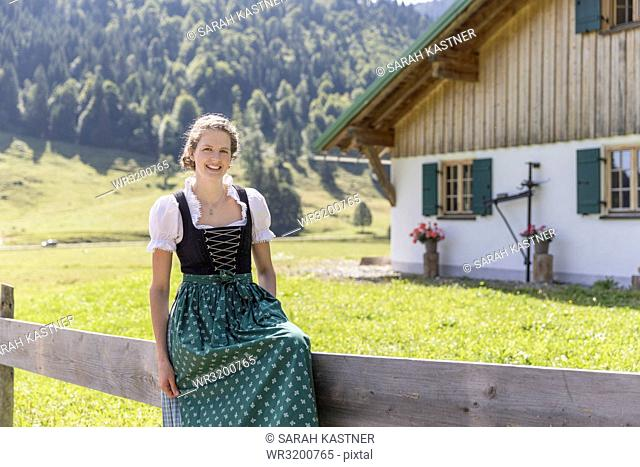 Portrait of a young countrywoman with dirndl