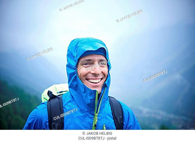 Portrait of hiker in wet conditions, Mont Cervin, Matterhorn, Valais, Switzerland