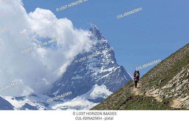 Man hiking towards the Matterhorn, Zermatt, Canton Wallis, Switzerland