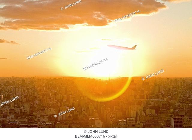 Plane ascending over city skyline, Buenos Aires, Argentina