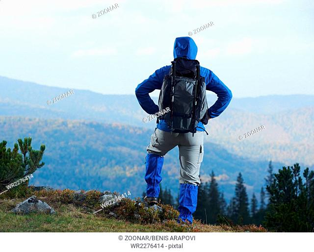 advanture man with backpack hiking