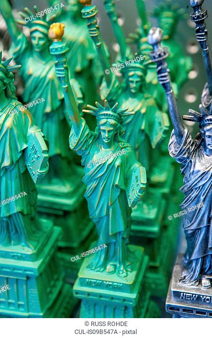 Statue of Liberty souvenirs in shop window, Manhattan, New York, USA