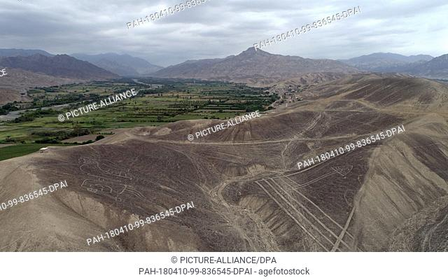 09 April 2018, Peru, Palpa: Aerial view of the geometrical figures and lines as well as animal and plant depictions. The newly discovered geoglyphs are located...