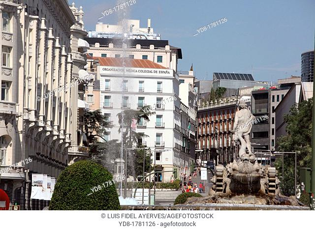 Neptune fountain overlooking the city center of Madrid, Spain, Europe
