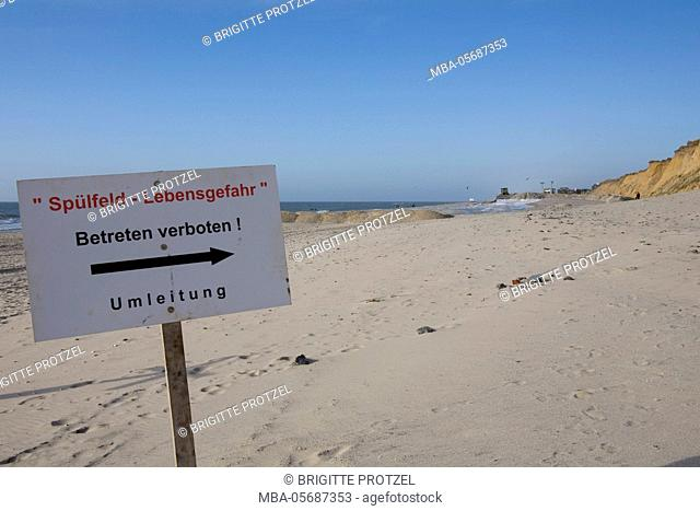 Sand replenishment at the red cliff, sign
