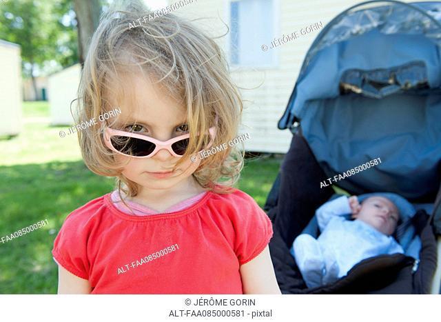 Little girl wearing sunglasses, portrait