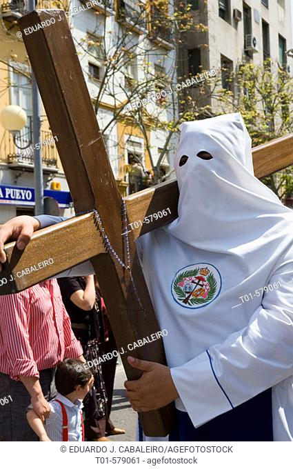 penitent with a cross in the Holy Week in Seville