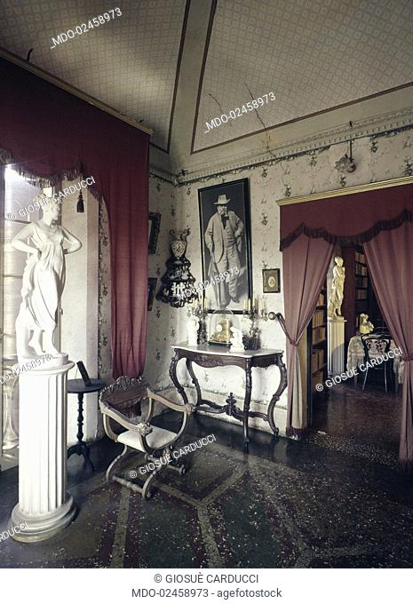 A corner in the livingroom of Italian poet and writer Giosuè Carducci's house. In the background, a picture of the poet. Bologna, 1960s