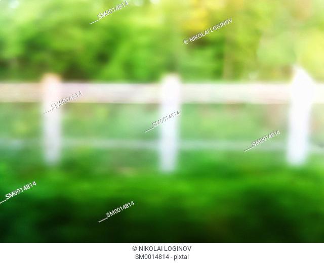 White fence on summer green bokeh backgroundhd