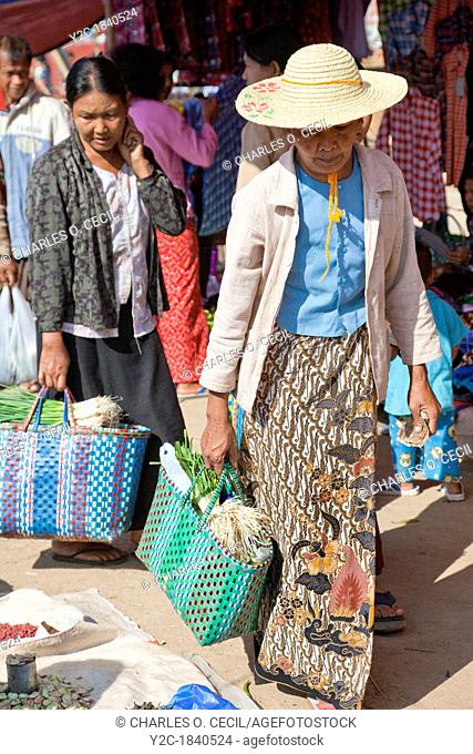 Myanmar, Burma  Burmese Women Shopping in the 'Five-Day' Market, Inle Lake, Shan State