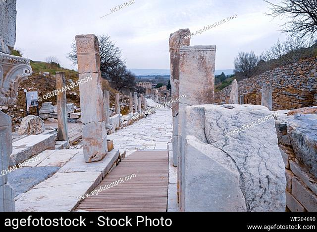 Selcuk, Izmir, Turkey - View of Celsus Library from Hercules Gate and Curetes Street in Ephesus ruins, historical ancient Roman archaeological sites in eastern...