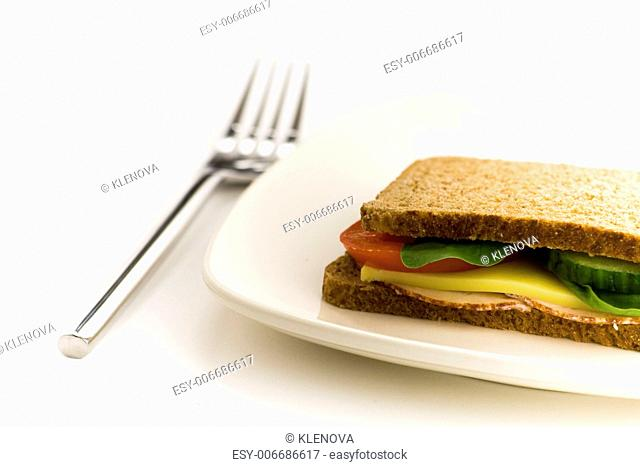 Sandwich on a white plate. Shallow depth of field