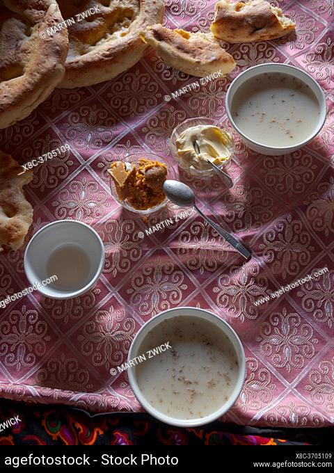Kumis, a fermented dairy prodct from mares milk, and traditional food in the yurt of a local herder. The Alaj valley in the Pamir Mountains, Asia, Central Asia
