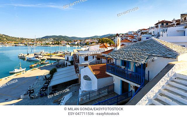View of the harbour in Skopelos town, Greece.