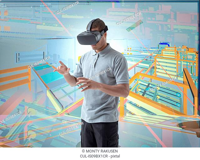Composite image of engineer using virtual reality headset in VR suite