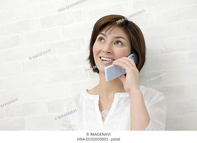 A woman using mobile phone