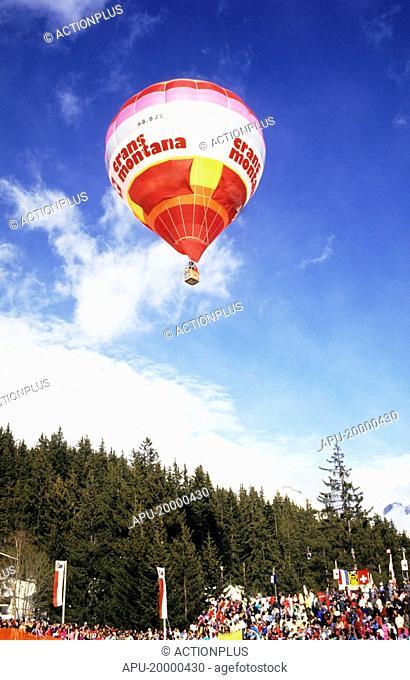 Hot air balloon in flight at a festival