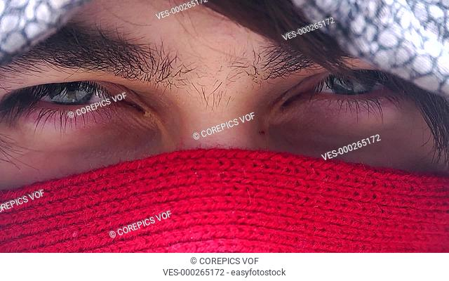 Short close up clip of a man's eyes, suddenly contracting to look angry