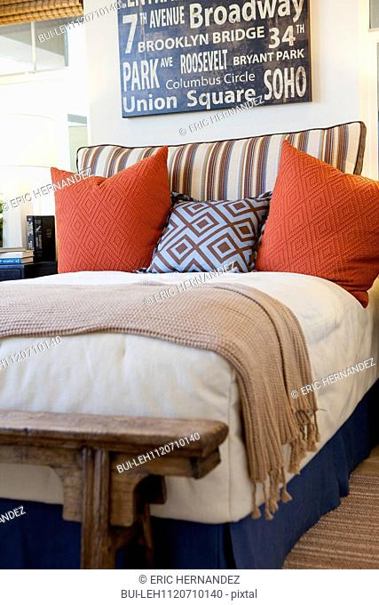 Arranged pillows on bed in the bedroom at home; San Marcos; California; USA