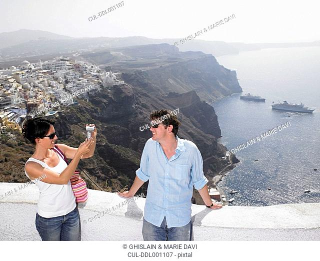 Woman taking pictures of her man