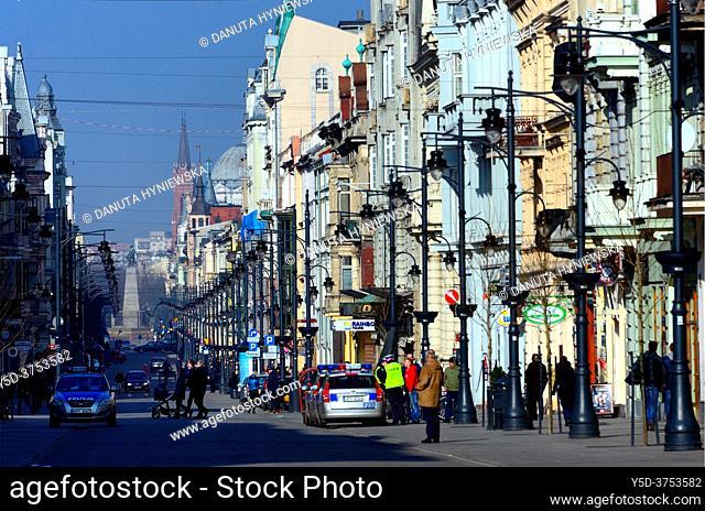 Piotrkowska street - main and most famous street of Lodz, in far background statue of national hero - Tadeusz Kosciuszko, Lodz, Poland, Europe